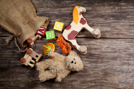 Vintage toys on wooden background Stock Photo