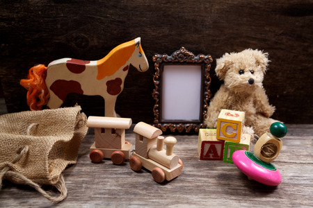 Vintage toys woth frame for photo on wooden background