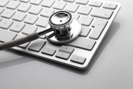 Silver Stethoscope on the keyboard