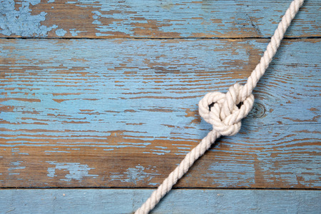 blue sea: Marine knot on blue wooden background