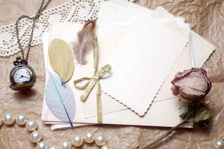 Old accessories and post cards. sentimental vintage background Stock Photo