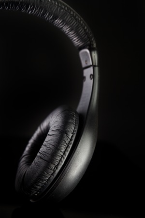aural: Headphones on a black background Stock Photo