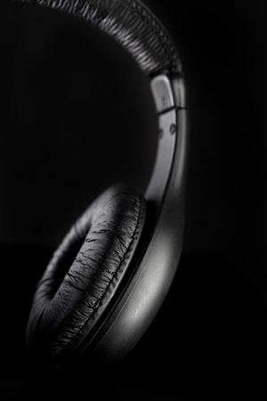 aural: Headphones on a black background Stock Photo