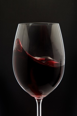 BLACK GLASS: Red Wine Glass silhouette on Black Background