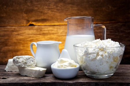 fresh milk products on wooden background