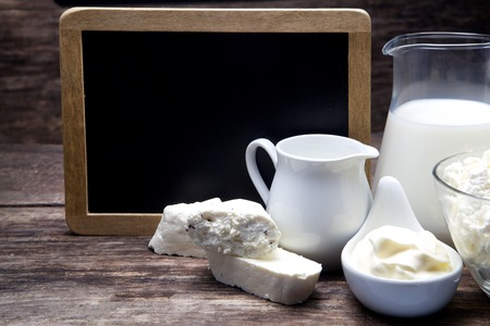 sideboard: Milk and Camembert cheese on sideboard with blackboard Stock Photo