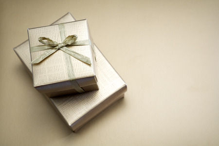 St.Valentines gift, golden box on golden background Stock Photo