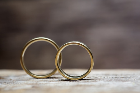 gold ring: Wedding rings on wooded background Stock Photo