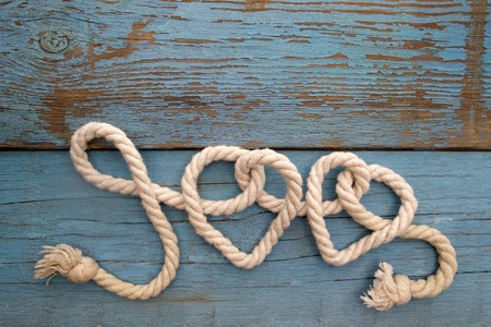 leash  rope into heart shape on wooden table Stock Photo - 41223306