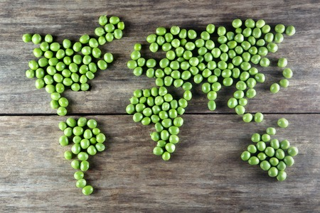 the natural world: world map made form  green peas