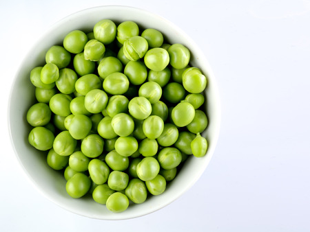 snap bean: Green peas in the bowl isolated on white background