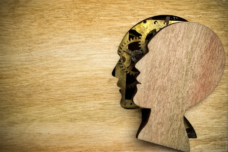 Human head silhouette model made from rusty metal gears