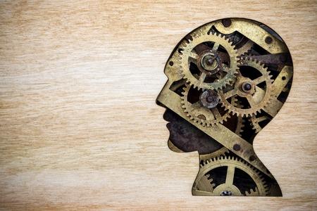 さびた金属歯車から作られた人間の頭のシルエット モデル 写真素材