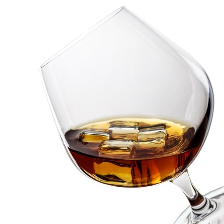 whiskey with ice in glass isolated on white background