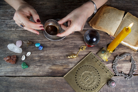 psychic reading: Witch - fortune teller reading fortune from coffee grounds Stock Photo