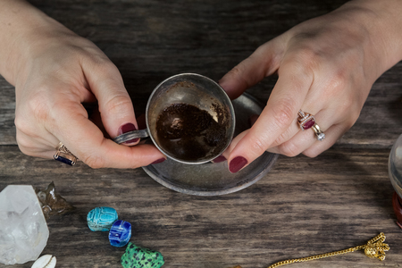 coffee grounds: Witch - fortune teller reading fortune from coffee grounds Stock Photo