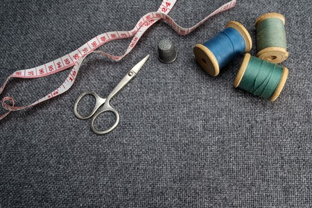sewing supplies: Sewing supplies on the grey fabric background