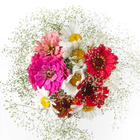 Beautiful bouquet of colorful flowers on bright background