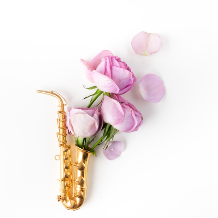 Jazz Day. Saxophone with flowers. Flat lay