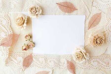 biege: Dried biege flowers andleaves wiht blank paper. Flat lay.