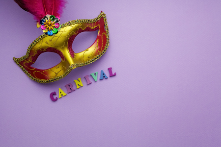 mardigras: Colorful mardi gras or carnivale mask on a purple background. Venetian masks. top view.
