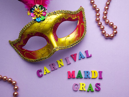 Colorful mardi gras or carnivale mask on a purple background. Venetian masks. top view.