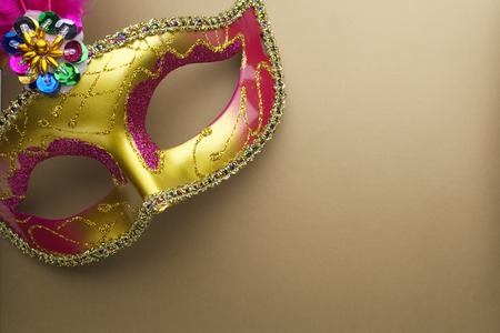 Colorful mardi gras or carnivale mask on a gold background. Venetian masks. top view.