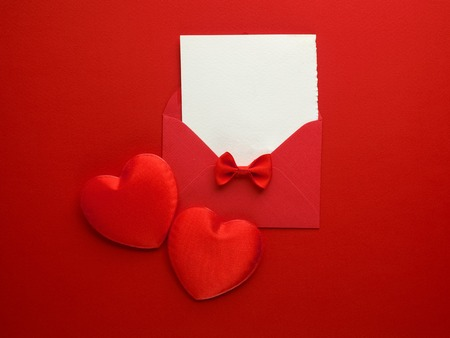 Envelope Mail, Heart and Ribbon on red Background. Valentine Day Card, Love or Wedding Greeting Concept. Top view Stock Photo
