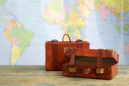 map case: Luggage on world map background. Travel concept