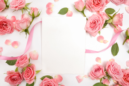 Framework from roses on white background. Flat lay. Stock Photo