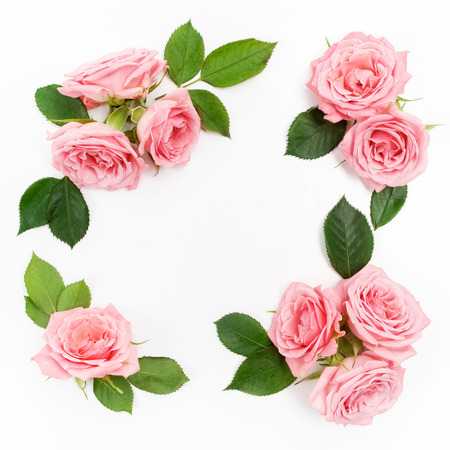 Framework from roses on white background. Flat lay. Banco de Imagens