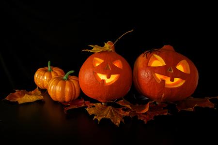 Halloween pumpkins heads jack lantern on dark background