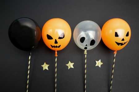 celebration smiley: holidays, decoration and party concept - air balloons for halloween over black background.Top view