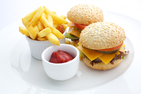 Cheesburger, french fries and ketchup