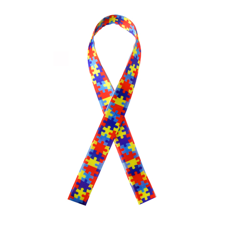 World Autism awareness and pride day or month with Puzzle pattern ribbon on white background.