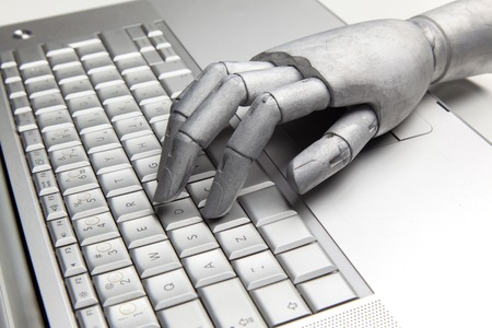Futuristic robot hand typing and working with laptop keyboard. Mechanical arm with computer
