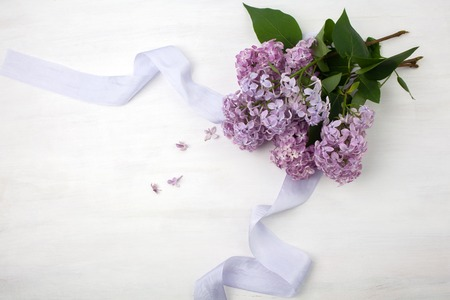 The beautiful lilac on a bright wooden background Stock Photo