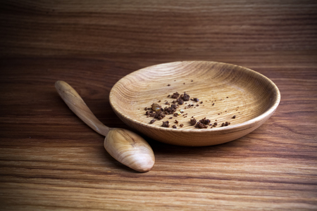 Fasting, Lent. Plate with spoon and crumb on wooden background