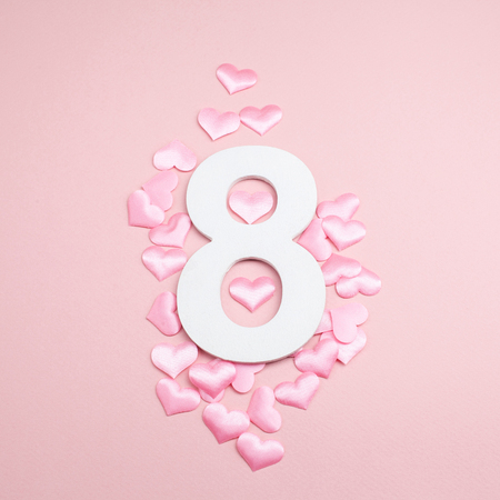 Happy womens day poster with number eight and hearts for greeting card, invitation