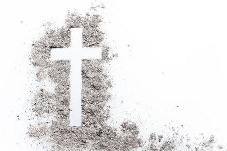 Ash wednesday cross, crucifix made of ash. Holiday, concept background