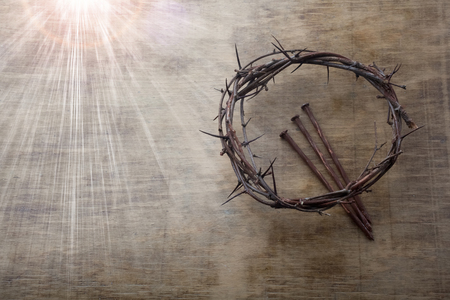 Jesus Crown Thorns and nails on Old and Grunge Wood Background. Vintage Retro Style. Free space for text Reklamní fotografie