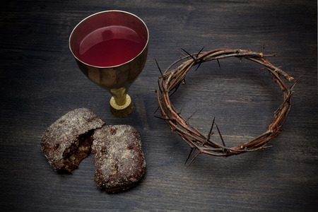 Communion And Passion - Unleavened Bread Chalice Of Wine And Crown Of Thorns Stock Photo