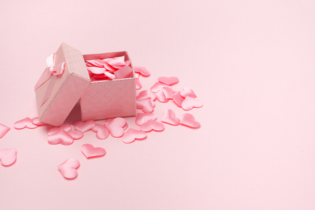 gift box open heart floating on pink background, love greeting concept 写真素材