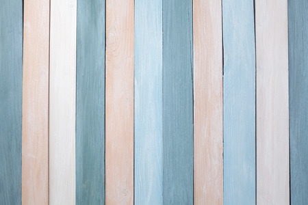 Pastellfarben hölzerner Wandhintergrund. Flach legen