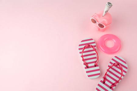 womans beach flip-flops on the light pastel pink background. beach summer concept and holiday concept, top view,