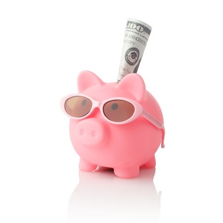 Piggy bank wearing retro sunglasses isolated on white background 写真素材 - 124625563