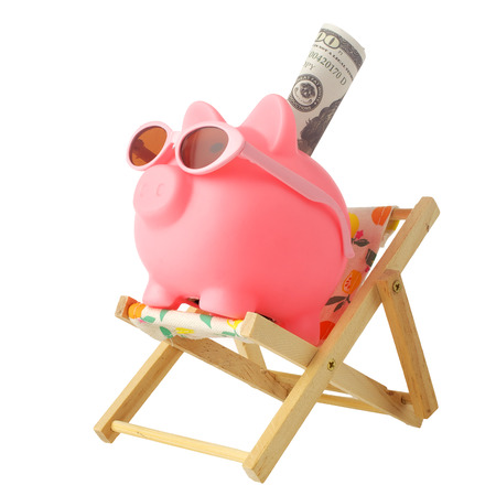 Piggy bank wearing retro sunglasses isolated on white background 写真素材 - 124625524