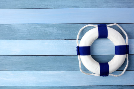 Hello Summer Background. Lifebuoy on wooden background texture. copy space for individual text.