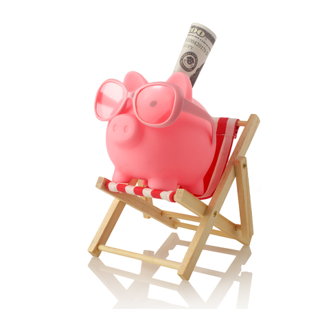 Piggy bank wearing retro sunglasses isolated on white background 写真素材 - 124625351