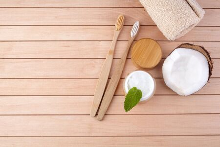 Coconut oil and mint homemade toothpaste, eco friendly bamboo toothbrush, natural healthcare. 免版税图像